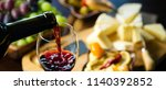 pouring red wine into the glass ... | Shutterstock . vector #1140392852