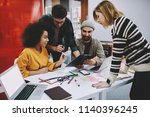 diverse team of creative male... | Shutterstock . vector #1140396245