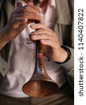 Small photo of Unidentified Turkish man performs Zurna(clarion)