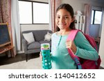 portrait of girl with backpack... | Shutterstock . vector #1140412652