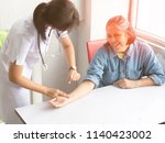 a kind nurse takes care woman...   Shutterstock . vector #1140423002
