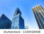 skyscrapers in financial... | Shutterstock . vector #1140428408