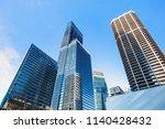 skyscrapers in financial... | Shutterstock . vector #1140428432