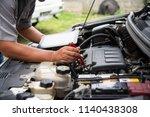 professional mechanic checking... | Shutterstock . vector #1140438308