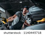 confused manual worker... | Shutterstock . vector #1140445718