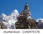 Small photo of Buddhist stupa and Ama Dablam summit in Khumbu region, Himalayas, Nepal. Everest base camp trek