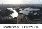 Small photo of Aerial photo of Amsterdam city center moving over modern office building then showing Nieuwmarkt en Lastage neighbourhood NEMO Science Museum and The National Maritime Museum