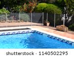 swimming pool with safety fence | Shutterstock . vector #1140502295