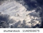 ragged clouds in shadow seem to ... | Shutterstock . vector #1140503075