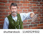 portrait of handsome bavarian... | Shutterstock . vector #1140529502
