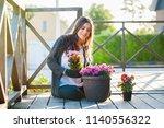 young woman gardening in pots... | Shutterstock . vector #1140556322