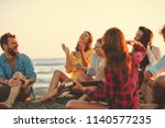 happy friends sitting on the... | Shutterstock . vector #1140577235