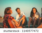 happy friends sitting on the... | Shutterstock . vector #1140577472