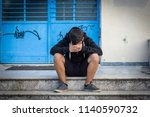 little boy sad sitting alone at ... | Shutterstock . vector #1140590732