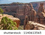 hiker is sitting on the cliff... | Shutterstock . vector #1140613565