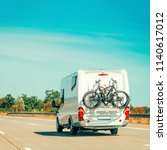 rv camper car with bicycles on... | Shutterstock . vector #1140617012