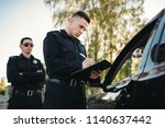 male police officers check... | Shutterstock . vector #1140637442