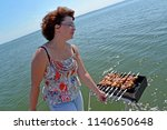 the woman prepares a shish... | Shutterstock . vector #1140650648