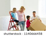 young family who does repair at ... | Shutterstock . vector #1140666458