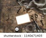 vintage photo frame  scissors ... | Shutterstock . vector #1140671405