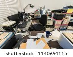 Messy Business Office With...
