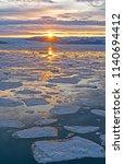 sunrise breaking through over... | Shutterstock . vector #1140694412