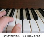 human hand on the piano... | Shutterstock . vector #1140695765