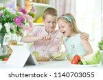 brother and sister cooking... | Shutterstock . vector #1140703055