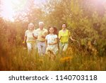 happy family resting | Shutterstock . vector #1140703118