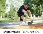 young man stretching body and... | Shutterstock . vector #1140705278