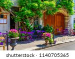 Cozy Street With Flowers And...