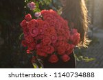 red roses bouquet in womans... | Shutterstock . vector #1140734888