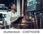 brewer standing near apparatus... | Shutterstock . vector #1140742658