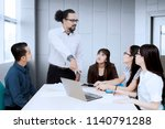 angry business manager pointing ... | Shutterstock . vector #1140791288