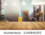 wood table on blur background... | Shutterstock . vector #1140846392