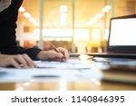 businessman working on laptop... | Shutterstock . vector #1140846395