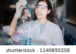 young asian scientist with test ... | Shutterstock . vector #1140850208