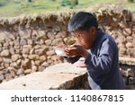native american kid eating in... | Shutterstock . vector #1140867815