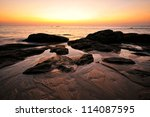 sunset with rock on the beach | Shutterstock . vector #114087595