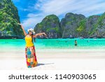 happy traveler asian girl in... | Shutterstock . vector #1140903065