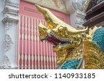 gold dargon in temple | Shutterstock . vector #1140933185
