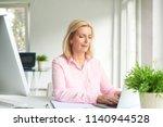 beautiful senior businesswoman... | Shutterstock . vector #1140944528