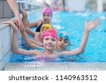 happy kids at the swimming pool.... | Shutterstock . vector #1140963512