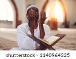 african muslim man making... | Shutterstock . vector #1140964325