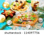 carp in jelly with carrot and cranberry and other traditional polish dishes on christmas table - stock photo