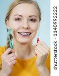 dentist and orthodontist... | Shutterstock . vector #1140992222