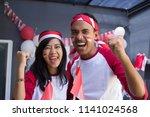 two happy asian people... | Shutterstock . vector #1141024568