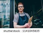 professional caucasian waiter... | Shutterstock . vector #1141045835