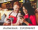 cheerful diverse friends... | Shutterstock . vector #1141046465