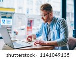 concentrated hipster student... | Shutterstock . vector #1141049135